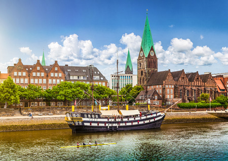architectural heritage of the world: Historic town of Bremen with old sailing ship on Weser river, Germany