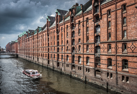 reeperbahn: Famous Speicherstadt warehouse district with dark clouds before the storm in Hamburg, Germany