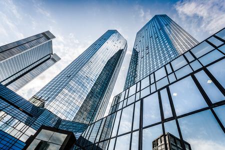 Modern skyscrapers in business district against blue sky Foto de archivo