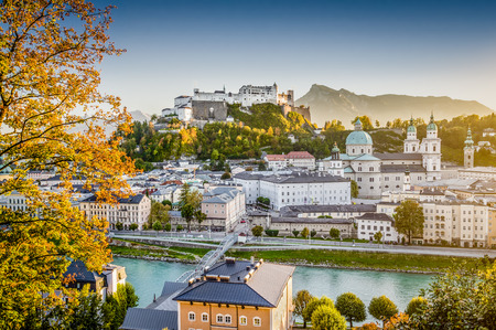 Aerial view of the historic city of Salzburg with Hohensalzburg Fortress in beautiful evening light in fall, Salzburger Land, Austria photo