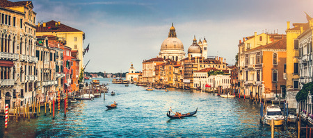 Panoramic view of famous Canal Grande and Basilica di Santa Maria della Salute at sunset in Venice, Italy with retro vintage Instagram style filter effect photo