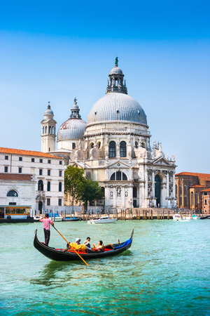 Traditional Gondola on Canal Grande with Basilica di Santa Maria della Salute in the background, Venice, Italy photo