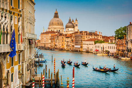canal house: Beautiful view of Gondolas on famous Canal Grande with Basilica di Santa Maria della Salute at sunset in Venice, Italy Stock Photo