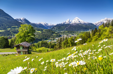 Beautiful mountain landscape in the Bavarian Alps with village of Berchtesgaden and Watzmann massif in the background at sunrise, Nationalpark Berchtesgadener Land, Bavaria, Germany