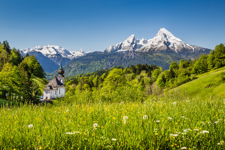 Beautiful mountain landscape in the Bavarian Alps with pilgrimage church of Maria Gern and Watzmann massif in the background, Nationalpark Berchtesgadener Land, Bavaria, Germany photo