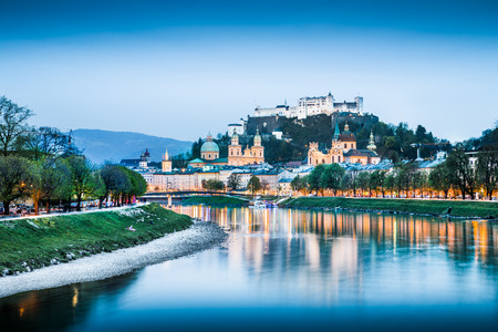 Salzburg cityscape with Festung Hohensalzburg and Salzach river at blue hour, Salzburger Land, Austria photo
