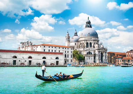 Traditional Gondola on Canal Grande with Basilica di Santa Maria della Salute in the background, Venice, Italy Stok Fotoğraf