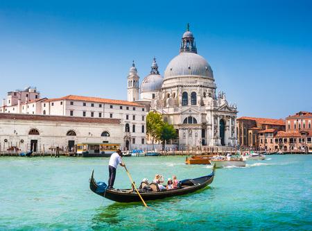 Traditional Gondola on Canal Grande with Basilica di Santa Maria della Salute in the background, Venice, Italy photo