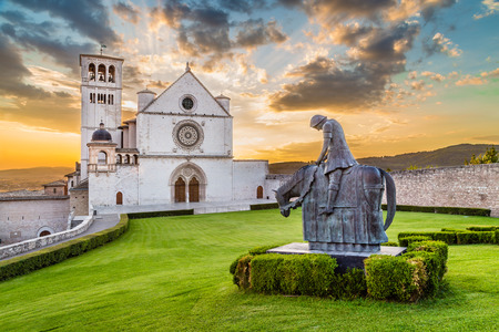 francesco: Famous Basilica of St Francis of Assisi with statue at sunset in Assisi, Umbria, Italy