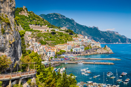 azure coast: Scenic picture-postcard view of the beautiful town of Amalfi at famous Amalfi Coast with Gulf of Salerno, Campania, Italy