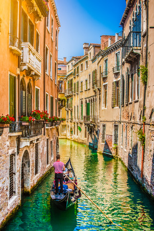 Beautiful scene with traditional gondola and canal in Venice, Italy 스톡 콘텐츠