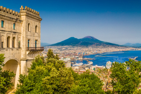 Scenic picture-postcard view of the city of Naples with famous Mount Vesuvius in the background from Certosa di San Martino monastery, Campania, Italy Фото со стока