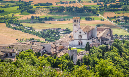 st  francis: Famous Basilica of St. Francis of Assisi at sunset in Assisi, Umbria, Italy Stock Photo