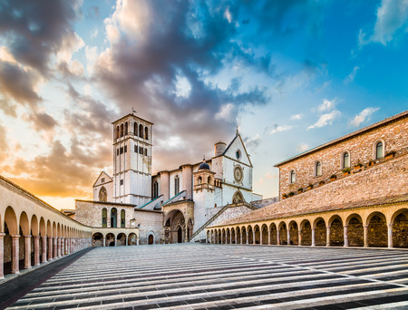 Famous Basilica of St. Francis of Assisi with Lower Plaza at sunset in Assisi, Umbria, Italy