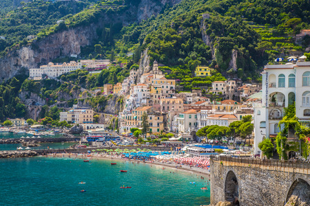 amalfi: Scenic picture-postcard view of the beautiful town of Amalfi at famous Amalfi Coast with Gulf of Salerno, Campania, Italy