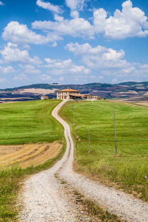 val d      orcia: Scenic Tuscany landscape with traditional farm house and rolling hills in Val d Orcia, Tuscany, Italy