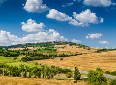 Beautiful Tuscany landscape with the old town of Pienza on a hill in summertime, Val d Orcia, Tuscany, Italy photo
