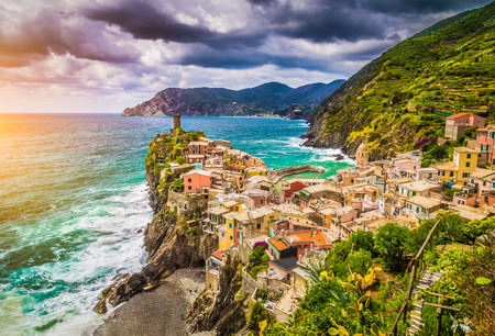 vernazza: Beautiful view of Vernazza, one of the five famous fisherman villages of Cinque Terre with dramatic cloudscape at sunset in Liguria, Italy