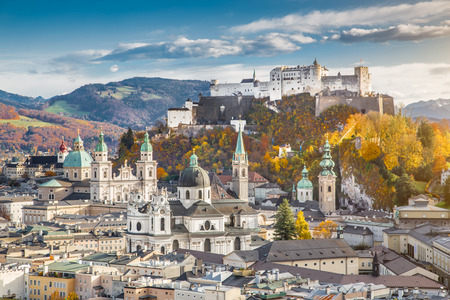 fall: Aerial view of the historic city of Salzburg with Hohensalzburg Fortress in beautiful evening light in fall, Salzburger Land, Austria