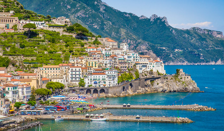 amalfi: Scenic picture-postcard view of the beautiful town of Amalfi at famous Amalfi Coast with Gulf of Salerno, Campania, Italy