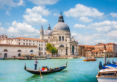 venice canal: Traditional Gondola on Canal Grande with Basilica di Santa Maria della Salute in the background, Venice, Italy Stock Photo