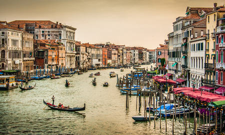 rialto bridge: Panoramic view of famous Canal Grande from famous Rialto Bridge at sunset in Venice, Italy with retro vintage Instagram style filter effect