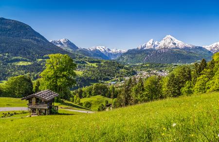 berchtesgaden: Beautiful mountain landscape in the Bavarian Alps with village of Berchtesgaden and Watzmann massif in the background at sunrise, Nationalpark Berchtesgadener Land, Bavaria, Germany