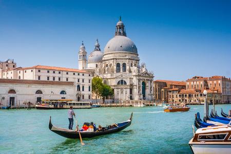 panoramic nature: Traditional Gondola on Canal Grande with Basilica di Santa Maria della Salute in the background, Venice, Italy Stock Photo