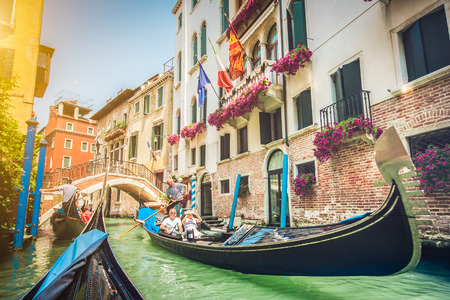 Gondolas on canal in Venice, Italy photo