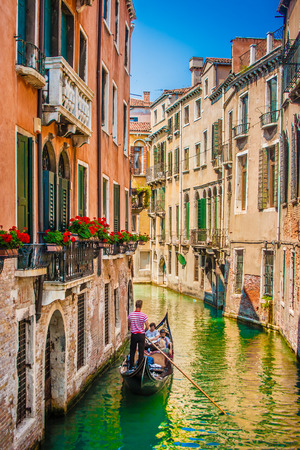 Beautiful scene with traditional gondola and canal in Venice, Italy Standard-Bild