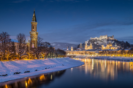Beautiful view of the historic city of Salzburg with Salzach river in winter during blue hour, Salzburger Land, Austria photo