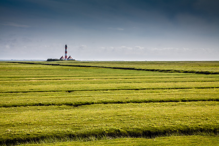 westerheversand: Beautiful landscape with famous Westerheversand lighthouse in the background at North Sea in Nordfriesland, Schleswig-Holstein, Germany Stock Photo