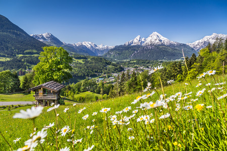 countryside landscape: Beautiful mountain landscape in the Bavarian Alps with village of Berchtesgaden and Watzmann massif in the background at sunrise, Nationalpark Berchtesgadener Land, Bavaria, Germany