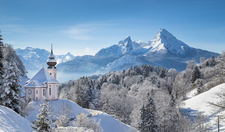 austrian village: Panoramic view of beautiful winter landscape in the Bavarian Alps with pilgrimage church of Maria Gern and famous Watzmann massif in the background, Nationalpark Berchtesgadener Land, Bavaria, Germany