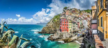 Panoramic view of Riomaggiore, one of the five famous fisherman villages of Cinque Terre in Liguria, Italy photo