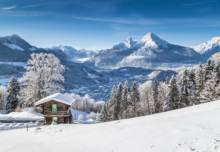 german swiss: Beautiful mountain landscape in the Bavarian Alps with village of Berchtesgaden and Watzmann massif in the background at sunrise, Nationalpark Berchtesgadener Land, Bavaria, Germany