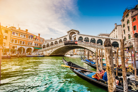 Panoramic view of famous Canal Grande with famous Rialto Bridge at sunset in Venice, Italy  photo