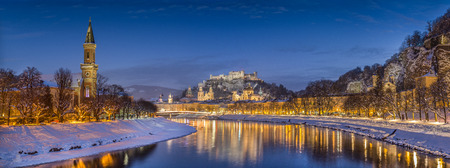 Panoramic view of the historic city of Salzburg with Salzach river in winter during blue hour, Salzburger Land, Austria photo