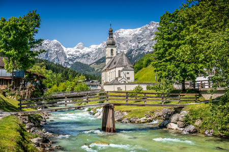 austrian village: Scenic mountain landscape in the Bavarian Alps with famous Parish Church of St. Sebastian in the village of Ramsau, Nationalpark Berchtesgadener Land, Upper Bavaria, Germany Stock Photo