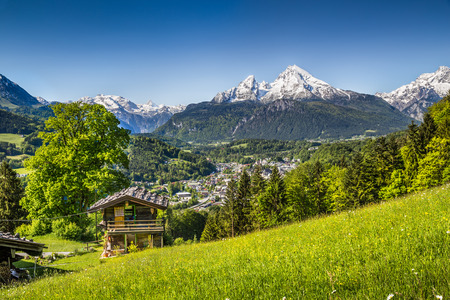 austrian village: Idyllic summer landscape in the Alps with traditional mountain lodge