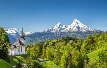 austrian village: Beautiful mountain landscape in the Bavarian Alps with pilgrimage church of Maria Gern and Watzmann massif in the background, Nationalpark Berchtesgadener Land, Bavaria, Germany