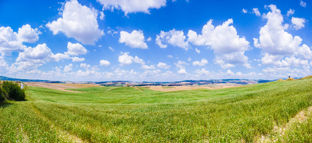val d      orcia: Scenic Tuscany landscape with rolling hills and beautiful cloudscape in Val d Orcia, Italy Stock Photo
