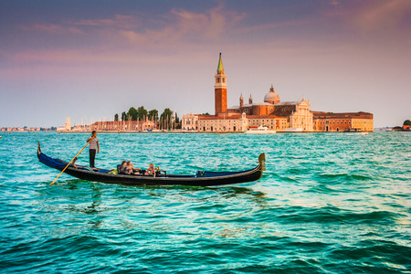 giorgio: Traditional Gondola on Canal Grande with San Giorgio Maggiore church in the background at sunset, San Marco, Venice, Italy Stock Photo