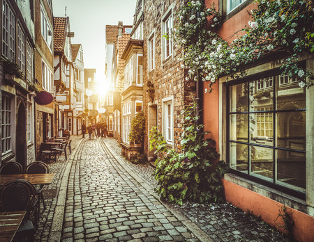 Old town in Europe at sunset with retro vintage  photo