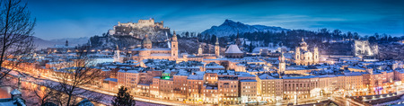 blue hour: Panoramic view of the historic city of Salzburg with Hohensalzburg in winter at blue hour, Salzburger Land, Austria Stock Photo