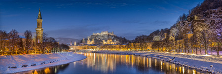 salzach: Panoramic view of the historic city of Salzburg with Salzach river in winter during blue hour, Salzburger Land, Austria