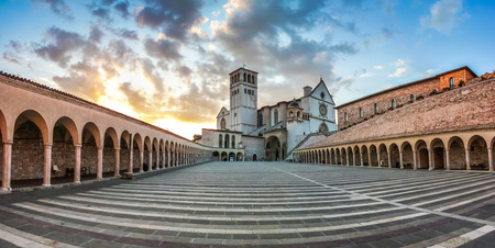 basilica: Famous Basilica of St. Francis of Assisi Basilica Papale di San Francesco with Lower Plaza at sunset in Assisi, Umbria, Italy
