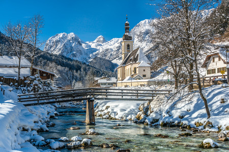 scenic  landscape: Panoramic view of scenic winter landscape in the Bavarian Alps with famous Parish Church of St. Sebastian in the village of Ramsau, Nationalpark Berchtesgadener Land, Upper Bavaria, Germany
