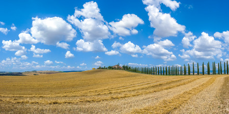 val dorcia: Beautiful Tuscany landscape with traditional farm house and dramatic clouds on a sunny day in Val dOrcia, Italy Stock Photo