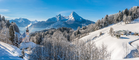 german swiss: Panoramic view of beautiful winter landscape in the Bavarian Alps with pilgrimage church of Maria Gern and famous Watzmann massif in the background, Nationalpark Berchtesgadener Land, Bavaria, Germany